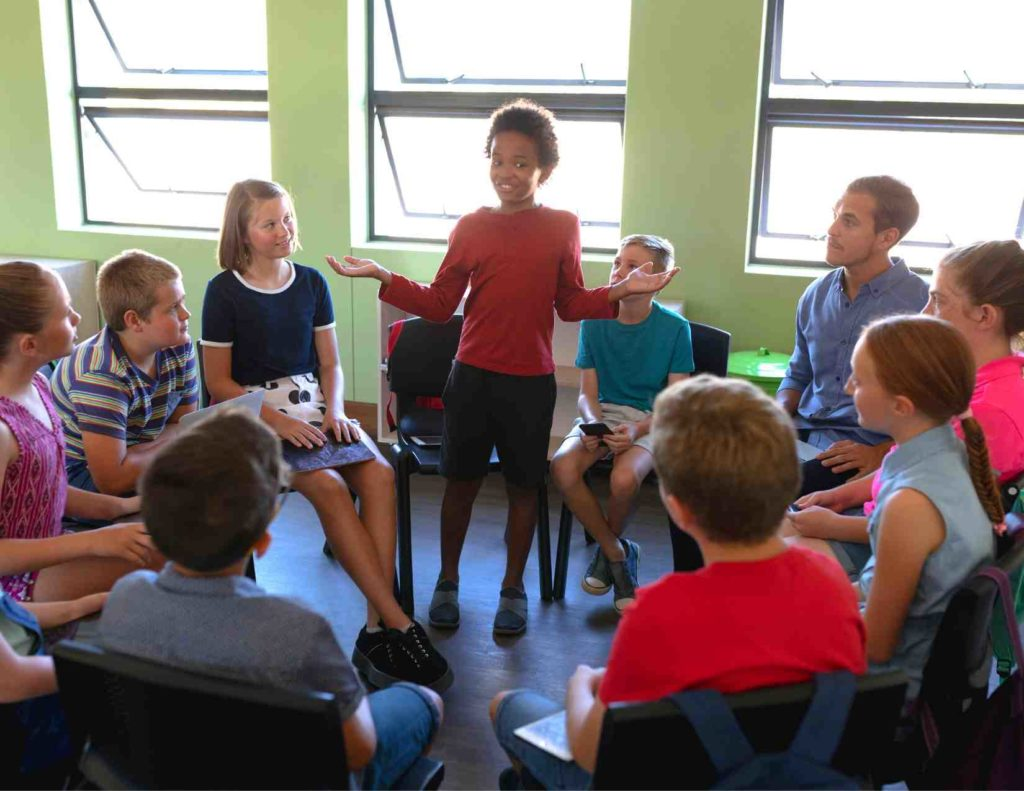 students in morning meeting to build positive relationships